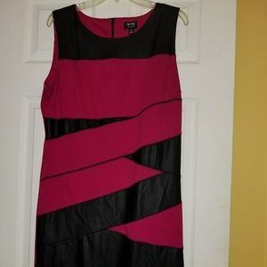 Comfortable knit dress with faux leather inserts